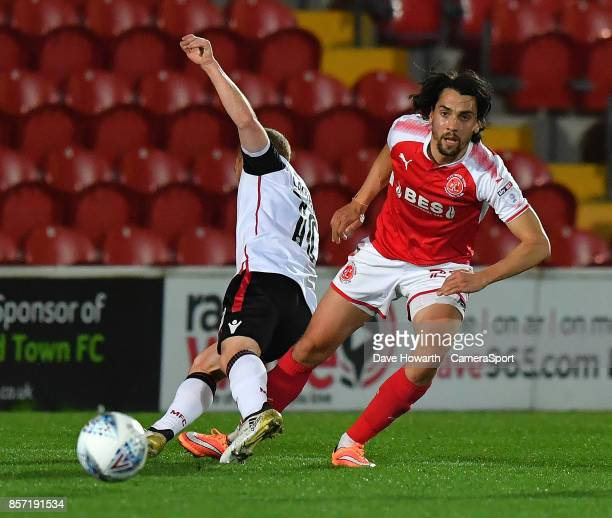 Morecambe's Adam Campbell is tackled by Fleetwood Town's Aiden O'Neill during the EFL Checkatrade Trophy Northern Section Group A match between...