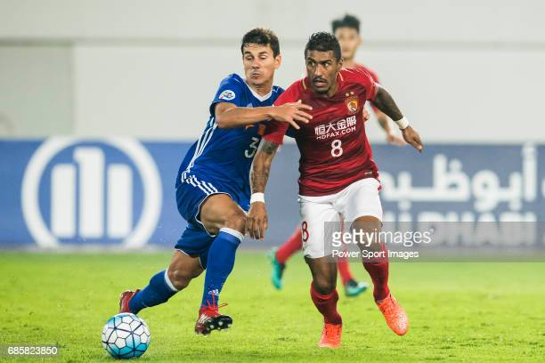Moreira Diego Eli of Eastern SC competes for the ball with Jose Paulo Bezerra Maciel Junior of Guangzhou Evergrande FC during their AFC Champions...