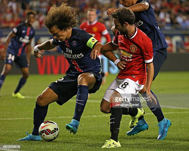 Moreira Marinho of Paris SaintGermain holds off Juan Mata of Manchester United during a match in the 2015 International Champions Cup at Soldier...