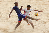 Moreira Ozu of Japan and Mohammad Ahmadzadeh of Iran compete for the ball during the Men's Beach Soccer gold medal match between Iran and Japan...