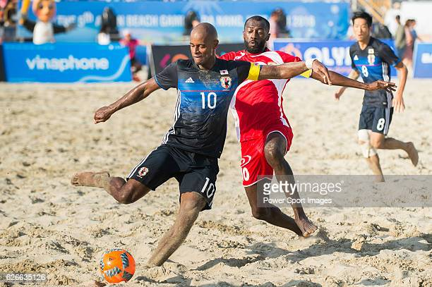 Moreira Ozu of Japan fights for the ball with Bait Al Noobi Hani Al Dhabat Faraj of Oman during the Beach Soccer Men's Team Gold Medal Match between...