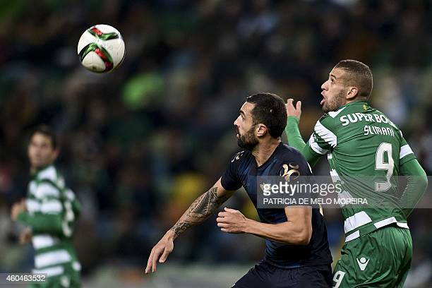 Moreirense's Brazilian defender Marcelo Oliveira vies with Sporting's Algerian forward Islam Slimani during the Portuguese Liga football match...