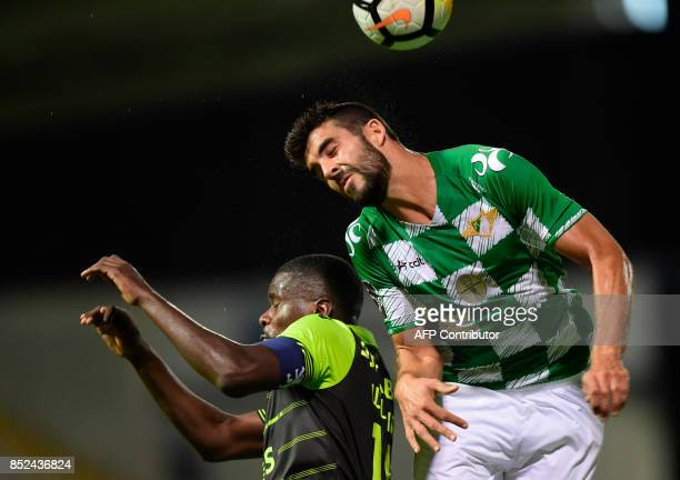 Moreirense's defender Andre Micael heads the ball with Sporting's midfielder William Carvalho during the Portuguese league football match Moreirense...