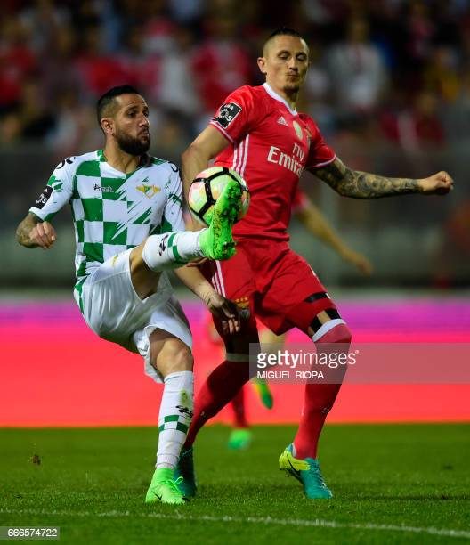 Moreirense's defender Pedro Rebocho vies with Benfica's Serbian midfielder Ljubomir Fejsa during the Portuguese league football match Moreirense vs...