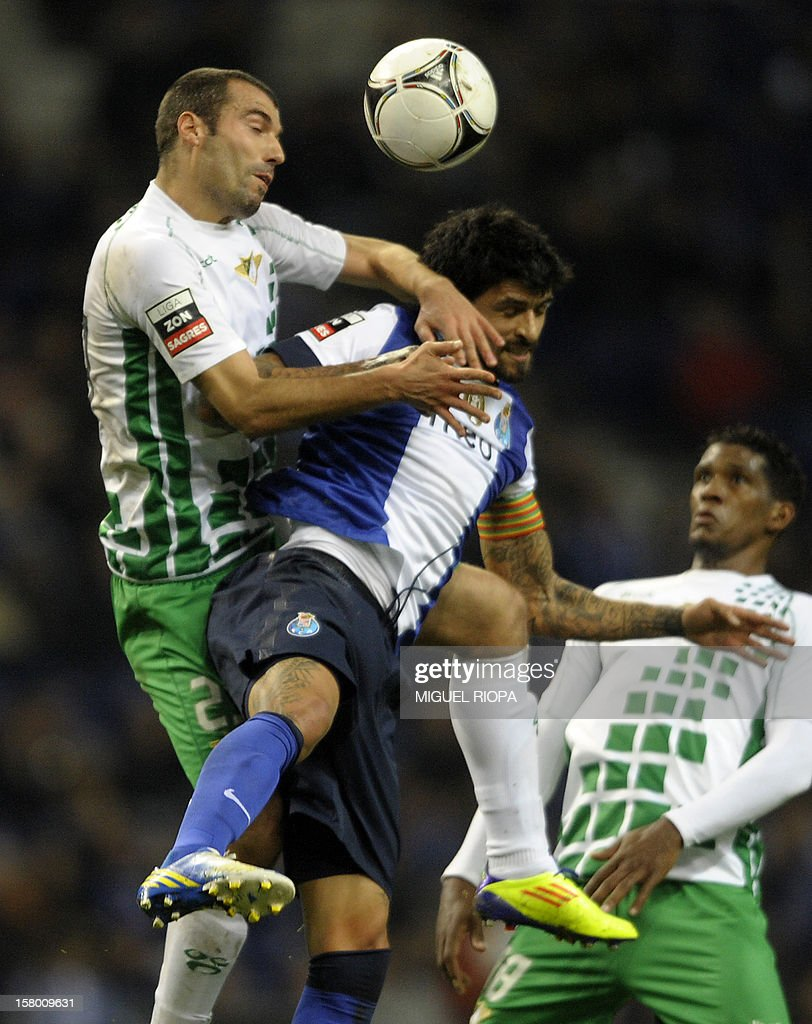 Moreirense's defender Ricardo Fernandes (L) jumps for the ball with Porto's Argentinian midfielder Lucho Gonzales during the Portuguese league football match FC Porto vs Moreirense at the Dragao Stadium in Porto on December 8, 2012.
