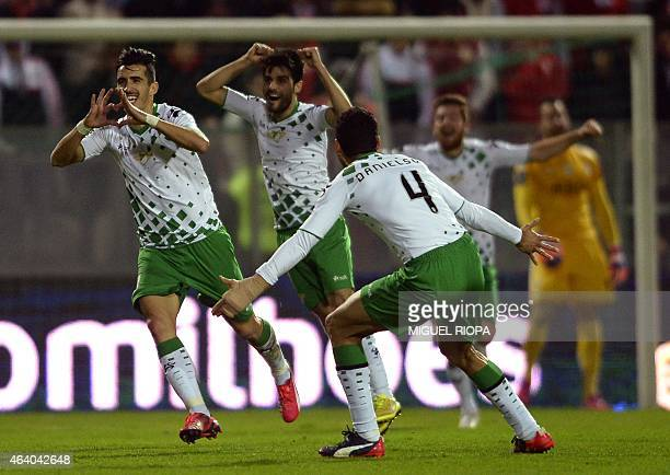 Moreirense's forward Joao Pedro celebrates with teammates after scoring a goal during the Portuguese league football match Moreirense FC vs SL...