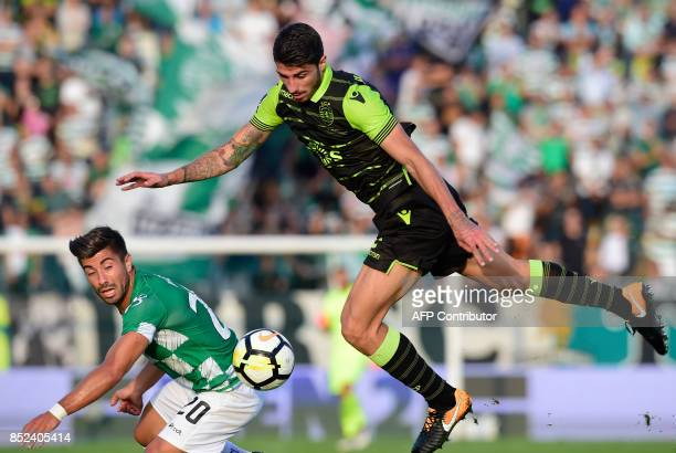 Moreirense's forward Toze vies with Sporting's defender Cristiano Piccini during the Portuguese league football match Moreirense FC vs Sporting CP at...