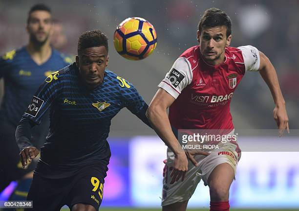 Moreirense's French defender Pierre Sagna vies with Sporting Braga's forward Rui Fonte during the Portuguese league football match SC Braga vs...