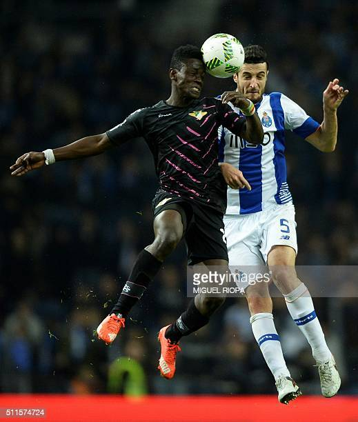 Moreirense's Ghanaian forward Emmanuel Boateng heads the ball with Porto's Spanish defender Ivan Marcano during the Portuguese league football match...