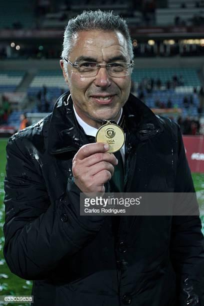 Moreirense's head coach Augusto Inacio from Portugal raise the Portuguese League Cup winner medal after the Portuguese League Cup Final between...