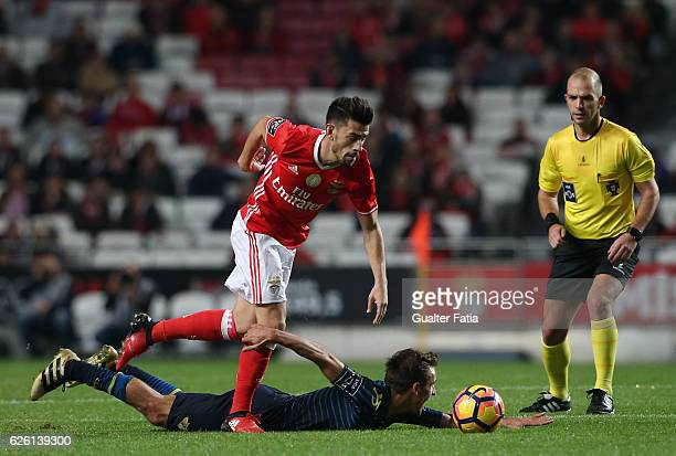 Moreirense's midfielder Francisco Geraldes tackled by SL Benfica's midfielder Pizzi during the Primeira Liga match between SL Benfica and Moreirense...