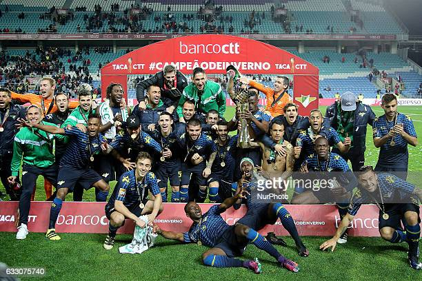 Moreirenses players raise the Portuguese trophy after winning the Final League Cup 2016/17 match between FC Moreirense v SC Braga at Algarve Stadium...