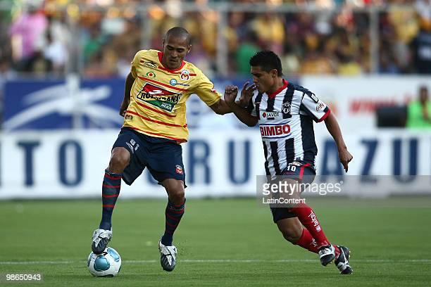 Morelia's Aldo Leao vies for the ball with Osvaldo Martinez of Monterrey during a 2010 Bicentenary Mexican championship soccer match between Monarcas...