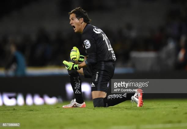 Morelia´s goalkeeper celebrates the goal of his teammate Raul Ruidiaz agaist Pumas during their Mexican Apertura tournament football match at the...