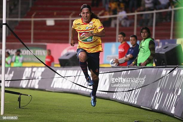 Morelia's Hugo Droguett celebrates after scoring a goal in a 2010 Bicentenary Mexican Championship soccer match between Monarcas Morelia and Jaguares...