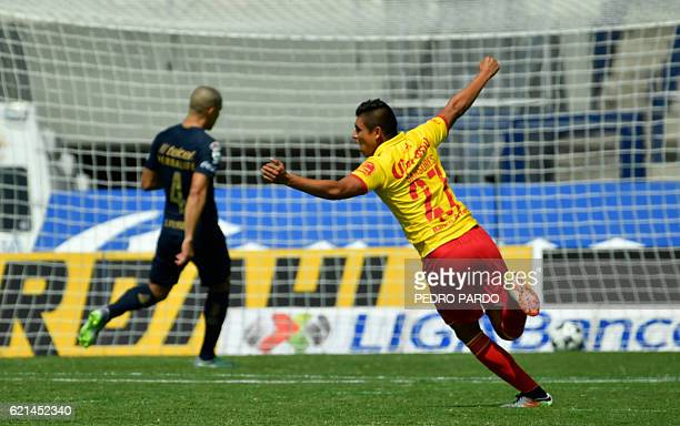 Morelia´s player Miguel Angel Sansore celebrates the goal of his teammate Raul Ruidiaz against Pumas during their Mexican Apertura tournament...