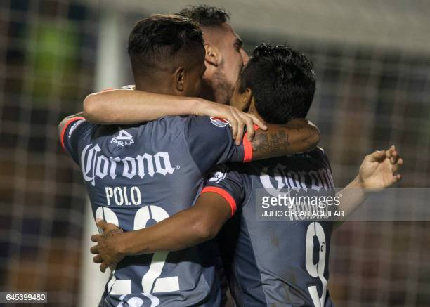 Morelia's players celebrate after scoring against Tigres during the Mexican Clausura 2017 tournament football match at the Universitario stadium in...