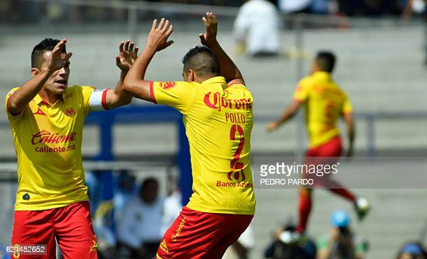 Morelia´s players celebrate the goal of their teammate Raul Ruidiaz against Pumas during their Mexican Apertura tournament football match at the...