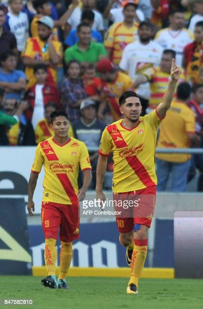 Morelia's Raul Ruidiaz and Diego Vilchis celebrate after scoring against Tigres during their Mexican Apertura 2017 tournament football match at the...