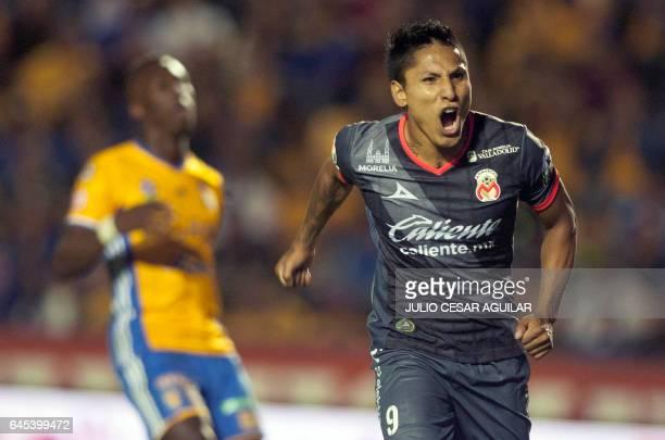 Morelia's Raul Ruidiaz celebrates after scoring against Tigres during the Mexican Clausura 2017 tournament football match at the Universitario...