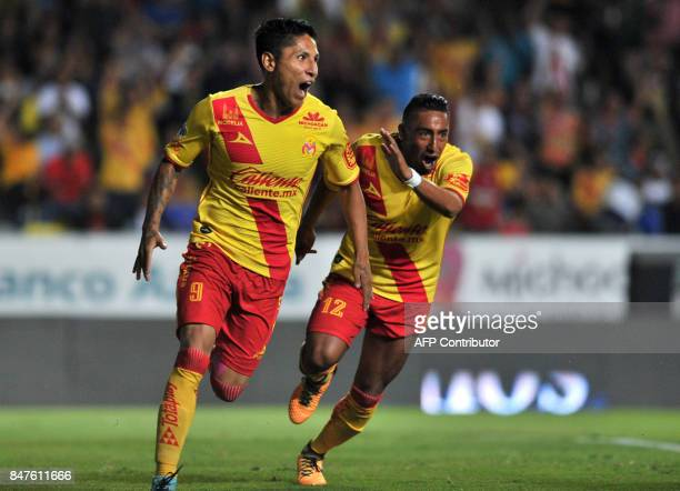Morelia's Raul Ruidiaz celebrates after scoring against Tigres during their Mexican Apertura 2017 tournament football match at the Morelos stadium in...