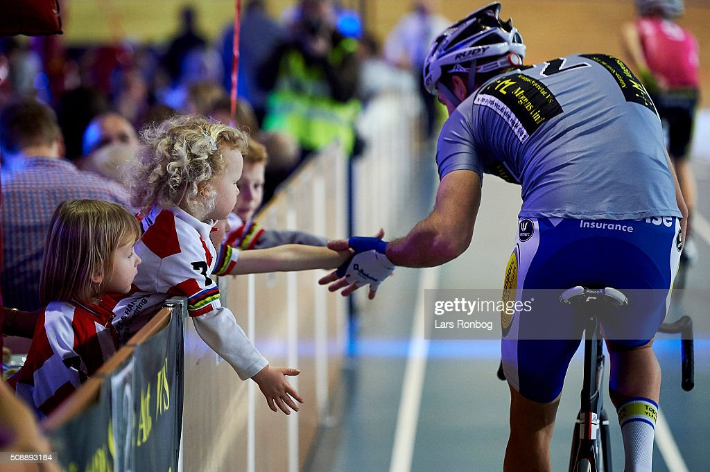 Moreno De Pauw gives high five to young fans during day four at the Copenhagen Six Days Race Cycling at Ballerup Super Arena on February 7, 2016 in Ballerup, Denmark.
