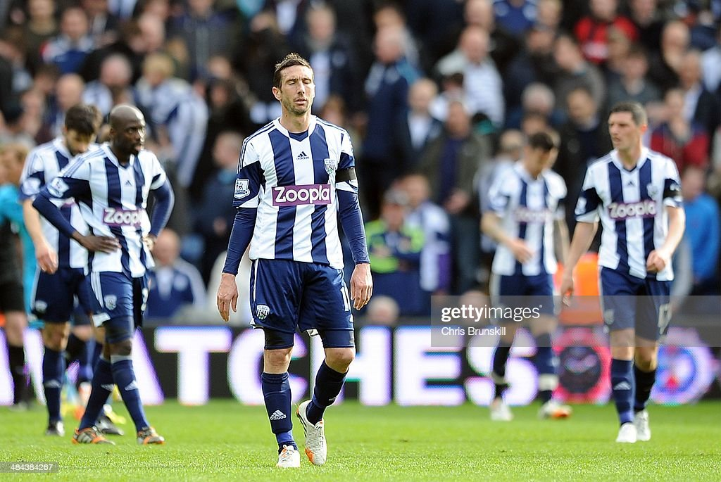 <a gi-track='captionPersonalityLinkClicked' href=/galleries/search?phrase=Morgan+Amalfitano&family=editorial&specificpeople=2528212 ng-click='$event.stopPropagation()'>Morgan Amalfitano</a> of West Bromwich Albion looks dejected following Tottenham Hotspur's third goal during the Barclays Premier League match between West Bromwich Albion and Tottenham Hotspur at The Hawthorns on April 12, 2014 in West Bromwich Albion, England.