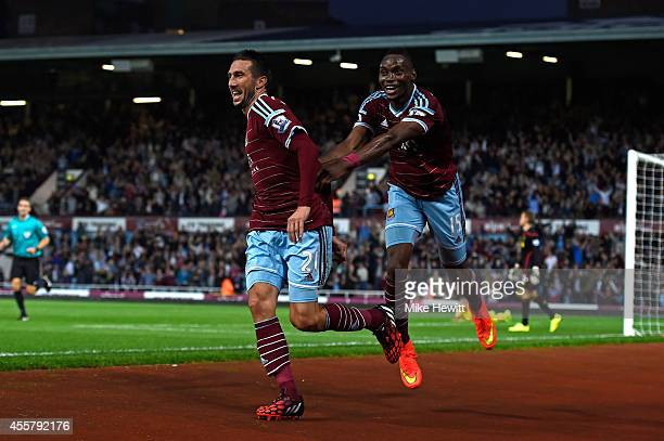 Morgan Amalfitano of West Ham celebrates with teammate Diafra Sakho of West Ham after scoring his team's third goal during the Barclays Premier...