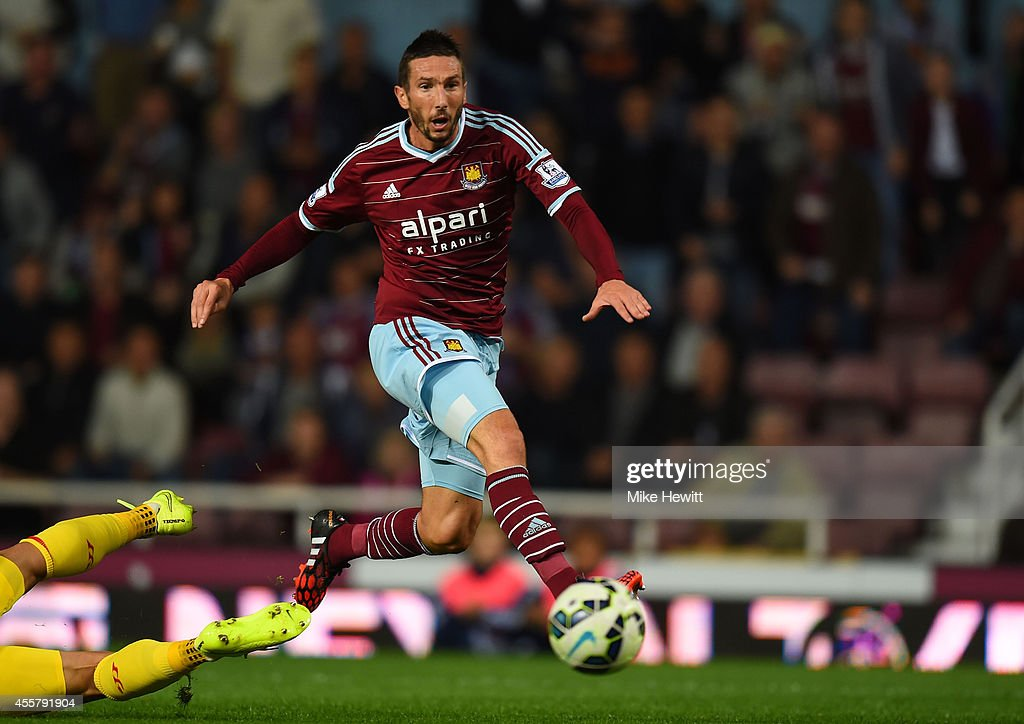 <a gi-track='captionPersonalityLinkClicked' href=/galleries/search?phrase=Morgan+Amalfitano&family=editorial&specificpeople=2528212 ng-click='$event.stopPropagation()'>Morgan Amalfitano</a> of West Ham scores his team's thrid goal during the Barclays Premier League match between West Ham United and Liverpool at Boleyn Ground on September 20, 2014 in London, England.