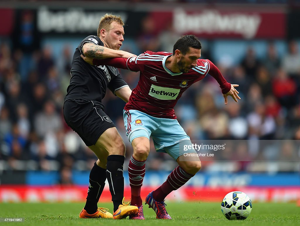 <a gi-track='captionPersonalityLinkClicked' href=/galleries/search?phrase=Morgan+Amalfitano&family=editorial&specificpeople=2528212 ng-click='$event.stopPropagation()'>Morgan Amalfitano</a> of West Ham United and Scott Arfield of Burnley compete for the ball during the Barclays Premier League match between West Ham United and Burnley at the Boleyn Ground on May 2, 2015 in London, England.