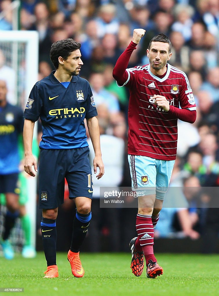 <a gi-track='captionPersonalityLinkClicked' href=/galleries/search?phrase=Morgan+Amalfitano&family=editorial&specificpeople=2528212 ng-click='$event.stopPropagation()'>Morgan Amalfitano</a> of West Ham United celebrates scoring the opening goal as Jesus Navas of Manchester City looks on during the Barclays Premier League match between West Ham United and Manchester City at Boleyn Ground on October 25, 2014 in London, England.