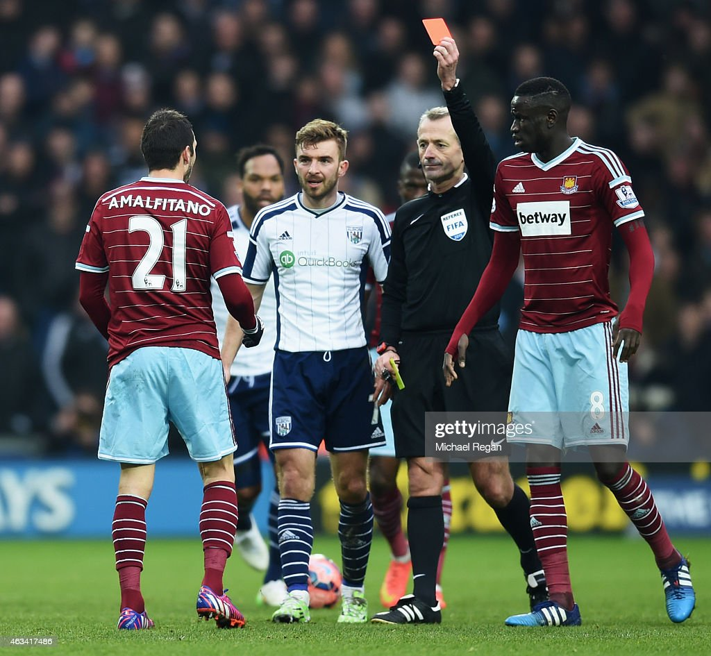 <a gi-track='captionPersonalityLinkClicked' href=/galleries/search?phrase=Morgan+Amalfitano&family=editorial&specificpeople=2528212 ng-click='$event.stopPropagation()'>Morgan Amalfitano</a> of West Ham United is shown a red card by referee <a gi-track='captionPersonalityLinkClicked' href=/galleries/search?phrase=Martin+Atkinson&family=editorial&specificpeople=703318 ng-click='$event.stopPropagation()'>Martin Atkinson</a> and is sent off during the FA Cup Fifth Round match between West Bromwich Albion and West Ham United at The Hawthorns on February 14, 2015 in West Bromwich, England.