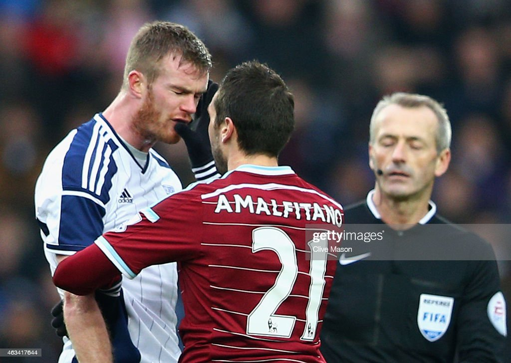 <a gi-track='captionPersonalityLinkClicked' href=/galleries/search?phrase=Morgan+Amalfitano&family=editorial&specificpeople=2528212 ng-click='$event.stopPropagation()'>Morgan Amalfitano</a> of West Ham United (21) pushes <a gi-track='captionPersonalityLinkClicked' href=/galleries/search?phrase=Chris+Brunt&family=editorial&specificpeople=809047 ng-click='$event.stopPropagation()'>Chris Brunt</a> of West Bromwich Albion in the face and is then sent off by referee <a gi-track='captionPersonalityLinkClicked' href=/galleries/search?phrase=Martin+Atkinson&family=editorial&specificpeople=703318 ng-click='$event.stopPropagation()'>Martin Atkinson</a> (R) during the FA Cup Fifth Round match between West Bromwich Albion and West Ham United at The Hawthorns on February 14, 2015 in West Bromwich, England.
