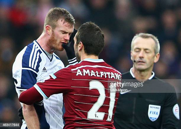 Morgan Amalfitano of West Ham United pushes Chris Brunt of West Bromwich Albion in the face and is then sent off by referee Martin Atkinson during...