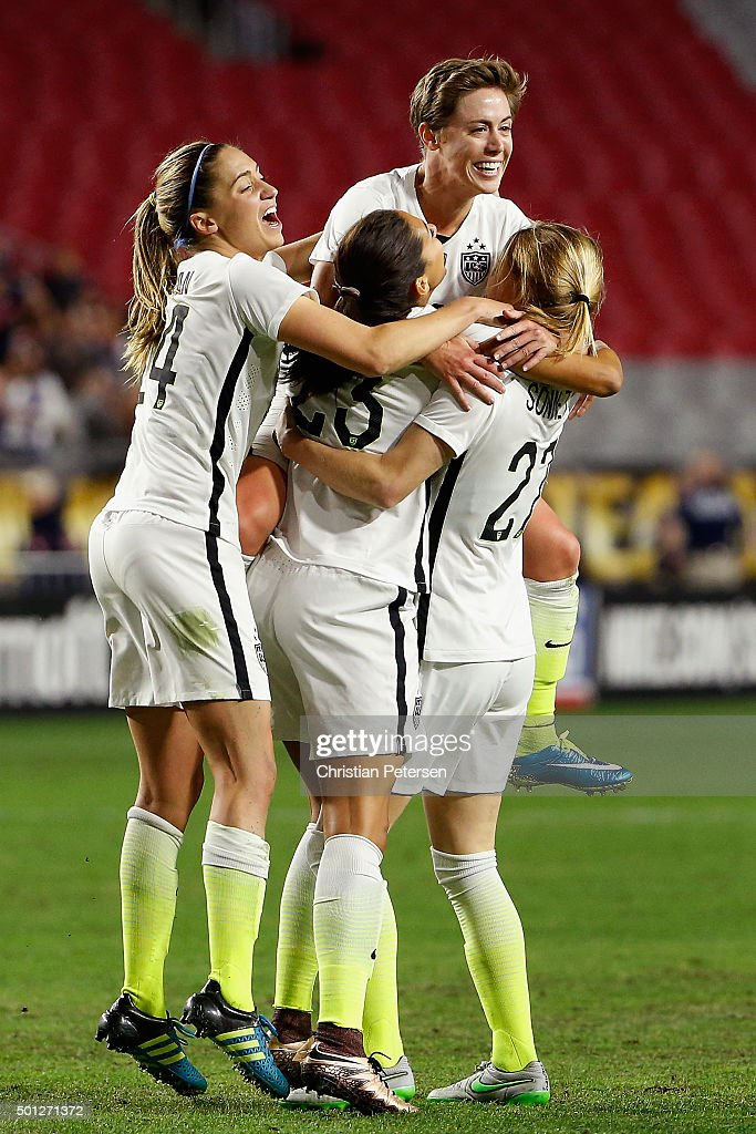 Morgan Brian #14, Christen Press #23, Meghan Klingenberg #22 and Emily Scott #27 of the United States celebrate after Press scored a second half goal against China during the women's soccer match at University of Phoenix Stadium on December 13, 2015 in Glendale, Arizona. USA defeated China 2-0.