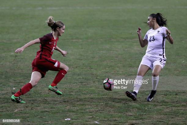 Morgan Brian of the United States passes the ball around Sakina Karchaoui of France during the 2017 SheBelieves Cup at RFK Stadium on March 7 2017 in...