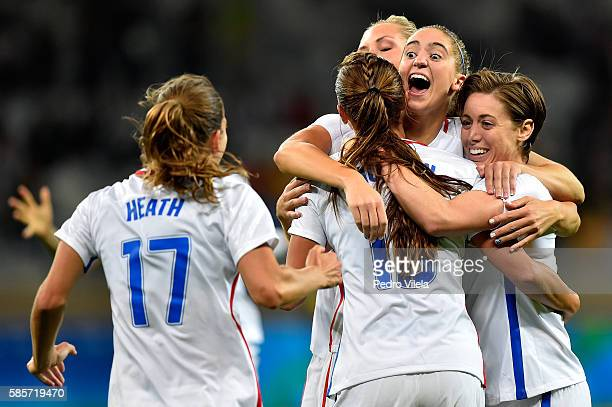 Morgan Brian of United States Tobin Heath of United States Meghan Klingenberg of United States and Alex Morgan of United States celebrate after Alex...