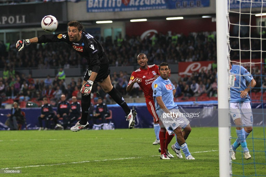 <a gi-track='captionPersonalityLinkClicked' href=/galleries/search?phrase=Morgan+De+Sanctis&family=editorial&specificpeople=615695 ng-click='$event.stopPropagation()'>Morgan De Sanctis</a> of Napoli dives to save a shot from David Ngog of Liverpool during the UEFA Europa League match between SSC Napoli and Liverpool played at Stadio San Paolo on October 21, 2010 in Naples, Italy.
