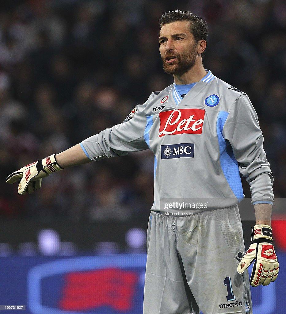 Morgan De Sanctis of SSC Napoli directs his defense during the Serie A match between AC Milan and SSC Napoli at San Siro Stadium on April 14, 2013 in Milan, Italy.