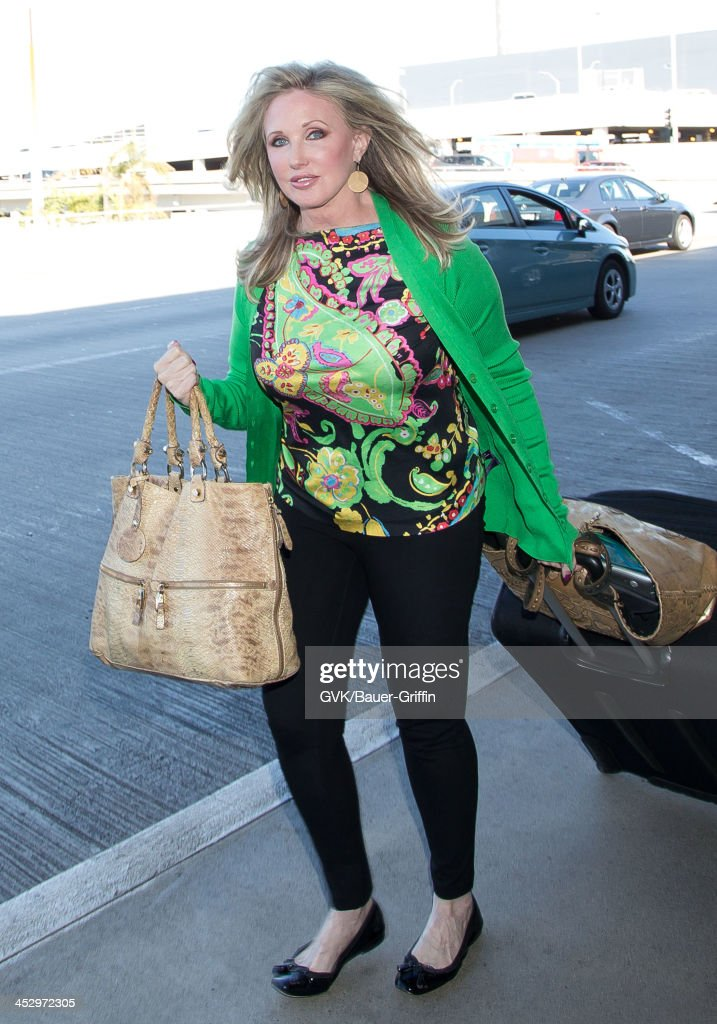 <a gi-track='captionPersonalityLinkClicked' href=/galleries/search?phrase=Morgan+Fairchild&family=editorial&specificpeople=213901 ng-click='$event.stopPropagation()'>Morgan Fairchild</a> is seen arriving at Los Angeles International airport on December 01, 2013 in Los Angeles, California.