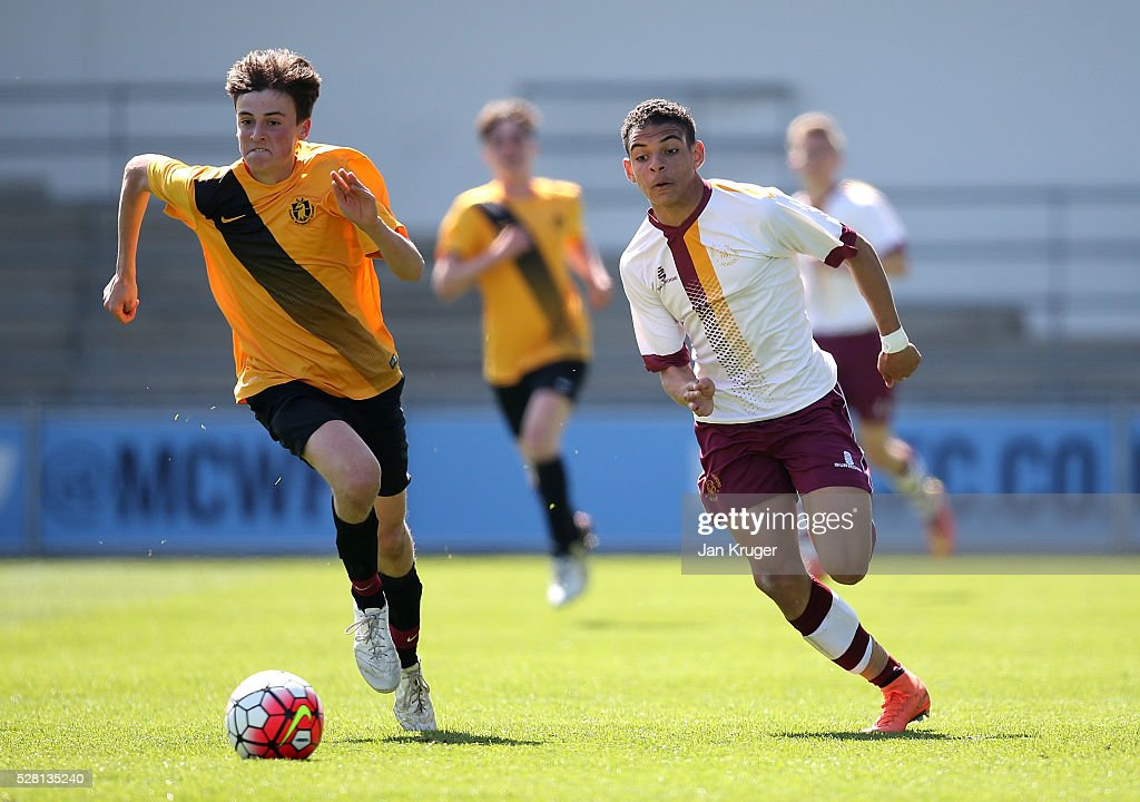 Morgan Gibbs-White of Thomas Telford School(R) battles with Harry Lowe of Samuel Whitbread Academy during the under 16 Schools' Cup final match between Thomas Telford School and Samuel Whitbread Academy at the Academy Training Ground on May 04, 2016 in Manchester, England.