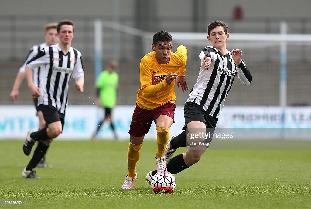 Morgan Gibbs-White of Thomas Telford School holds off Alfie Baeza-Collis of Dorothy Stringer School during the Premier League U16 Open Schools' final between Dorothy Stringer School and Thomas Telford School at the Etihad Campus on May 06, 2016 in Manchester, England.
