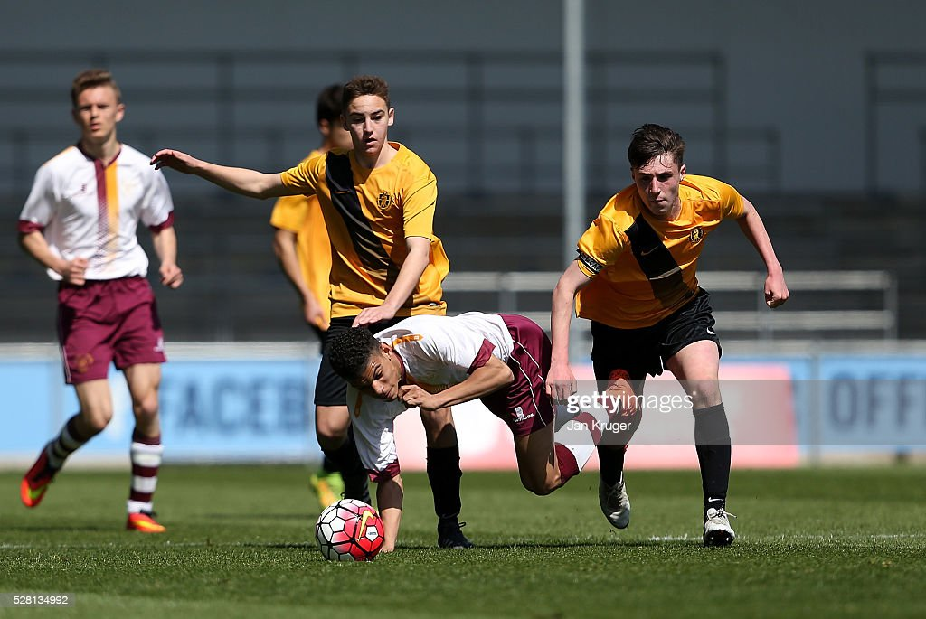 Morgan Gibbs-White of Thomas Telford School is tackled by Jack James of Samuel Whitbread Academy during the under 16 Schools' Cup final match between Thomas Telford School and Samuel Whitbread Academy at the Academy Training Ground on May 04, 2016 in Manchester, England.