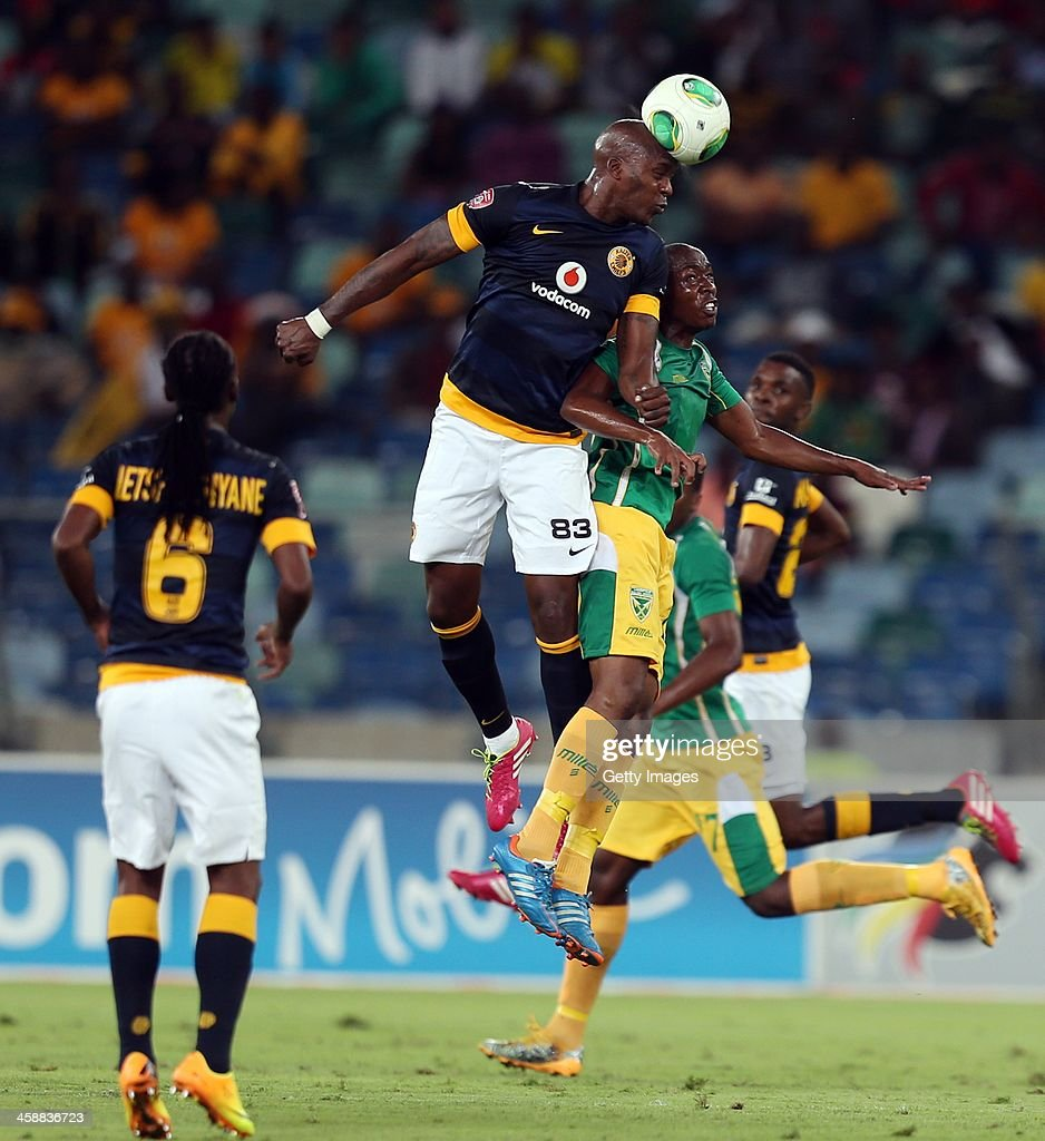 Morgan Gould of Kaizer Chiefs out jumps Ntlantla Zothwane (R) of Lamontville Golden Arrows during the Absa Premiership match between Golden Arrows and Kaizer Chiefs at Moses Mabhida Stadium on December 19, 2013 in Durban, South Africa.