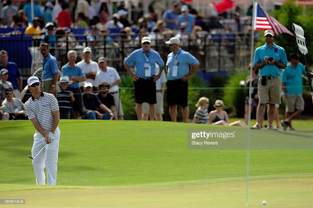 Morgan Hoffman hits his second shot to the 17th green during the third round of the Zurich Classic of New Orleans at TPC Louisiana on April 27, 2013 in Avondale, Louisiana.