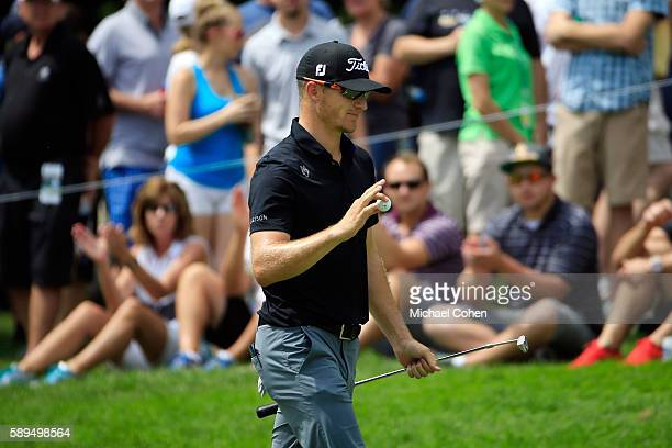 Morgan Hoffmann acknowledges the crowd on the fifth green during the final round of the John Deere Classic at TPC Deere Run on August 14 2016 in...