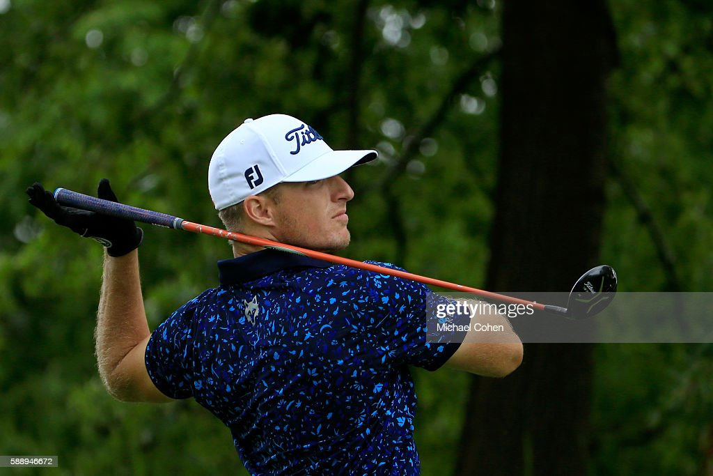 Morgan Hoffmann lets go of his golf club after a shot from the 11th tee during the second round of the John Deere Classic at TPC Deere Run on August...