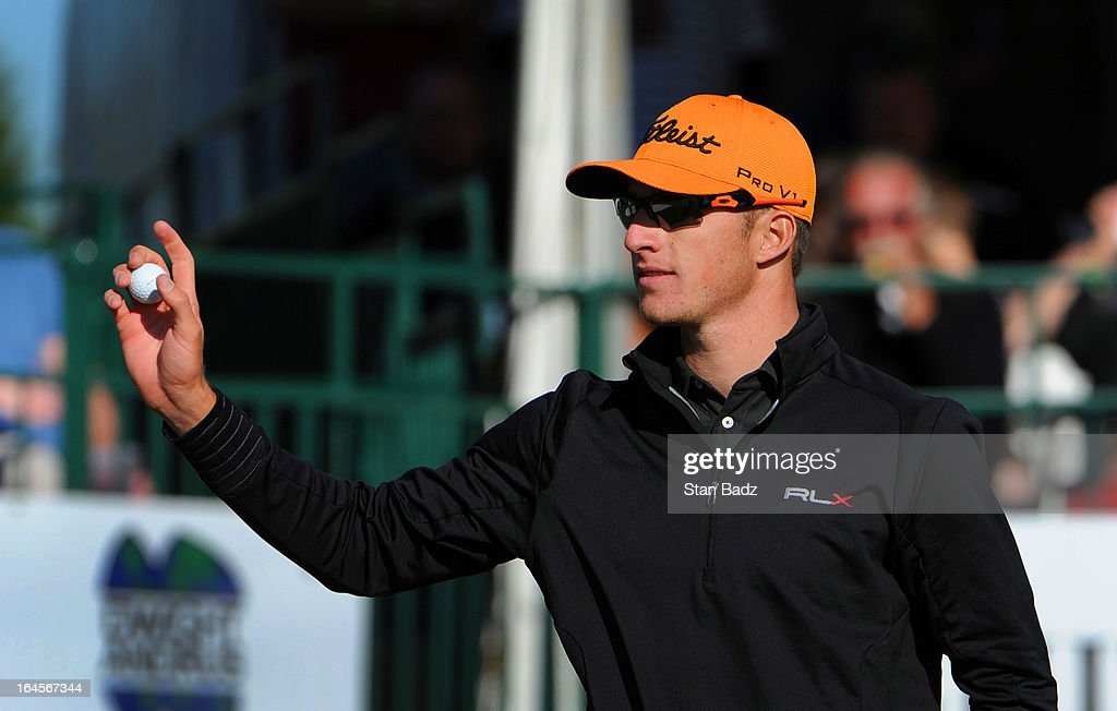 Morgan Hoffmann waves his golf ball to the gallery on the 18th hole during the final round of the Chitimacha Louisiana Open at Le Triomphe Country Club on March 24, 2013 in Broussard, Louisiana.