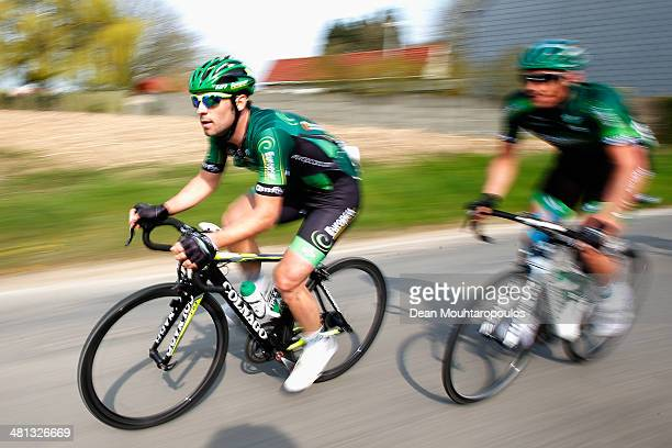 Morgan Lamoisson and Vincent Jerome both of France compete in the E3 Harelbeke Cycle Race on March 28 2014 in Harelbeke Belgium