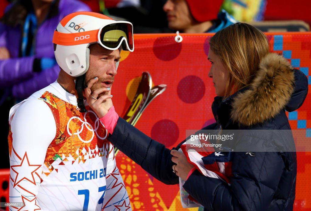 Morgan Miller (R) comforts her husband <a gi-track='captionPersonalityLinkClicked' href=/galleries/search?phrase=Bode+Miller&family=editorial&specificpeople=194742 ng-click='$event.stopPropagation()'>Bode Miller</a> of the United States during the Alpine Skiing Men's Super-G on day 9 of the Sochi 2014 Winter Olympics at Rosa Khutor Alpine Center on February 16, 2014 in Sochi, Russia.